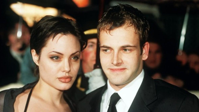 Angelina Jolie divorces husband number one, Jonny Lee Miller. Via Billy Bob Thornton (husband no.2) she finally gets together with Brad Pitt (husband no.3).