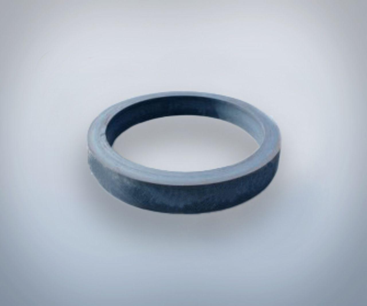 Ein schwarzer Ring auf grauem Hintergrund