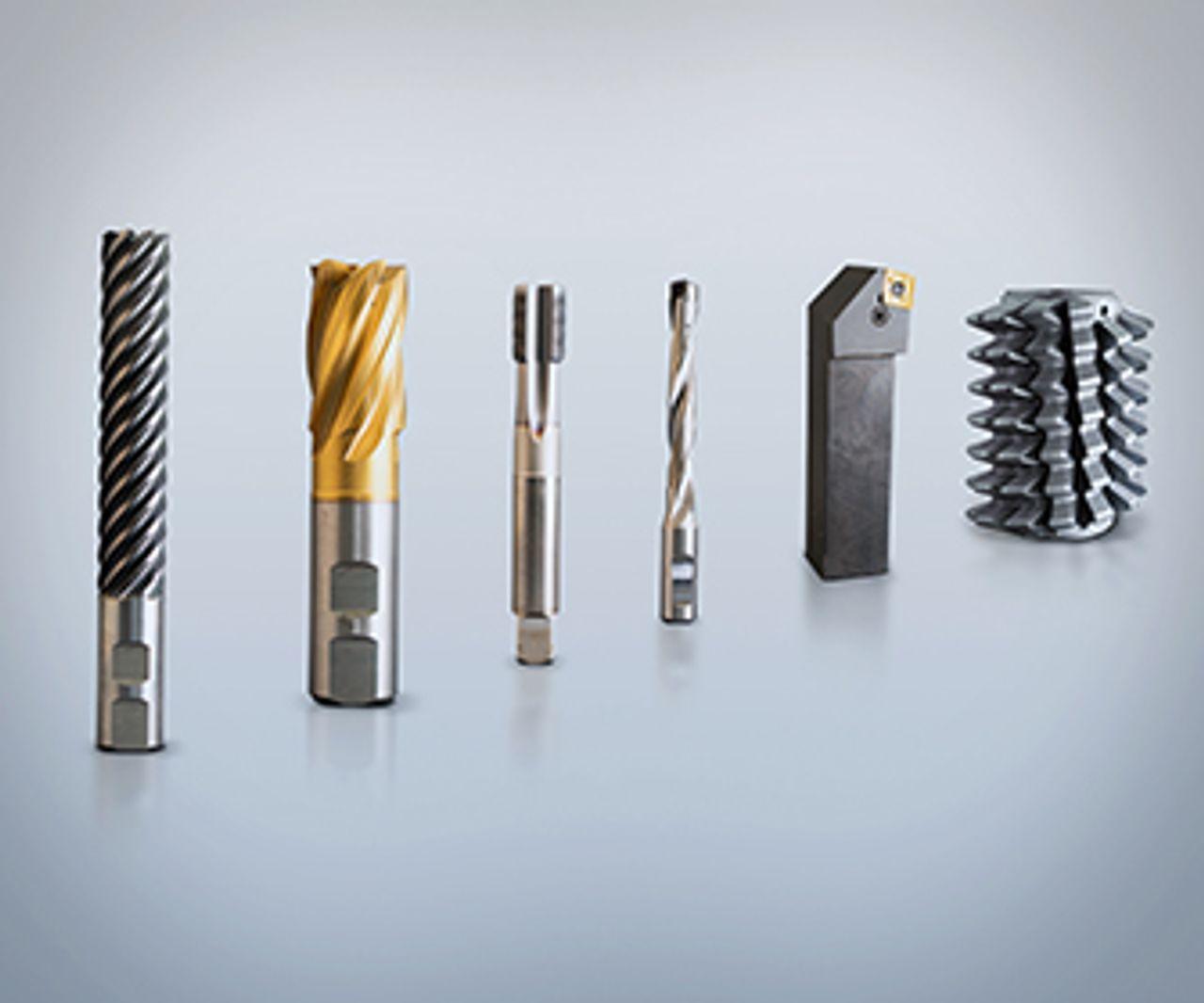 Sechs verschiedene Zerspanungswerkzeuge auf grauem Hintergrund