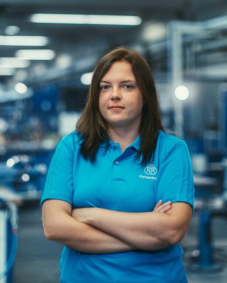 Lisa-Marie Winkelhorst, former apprentice, arms crossed, smiling