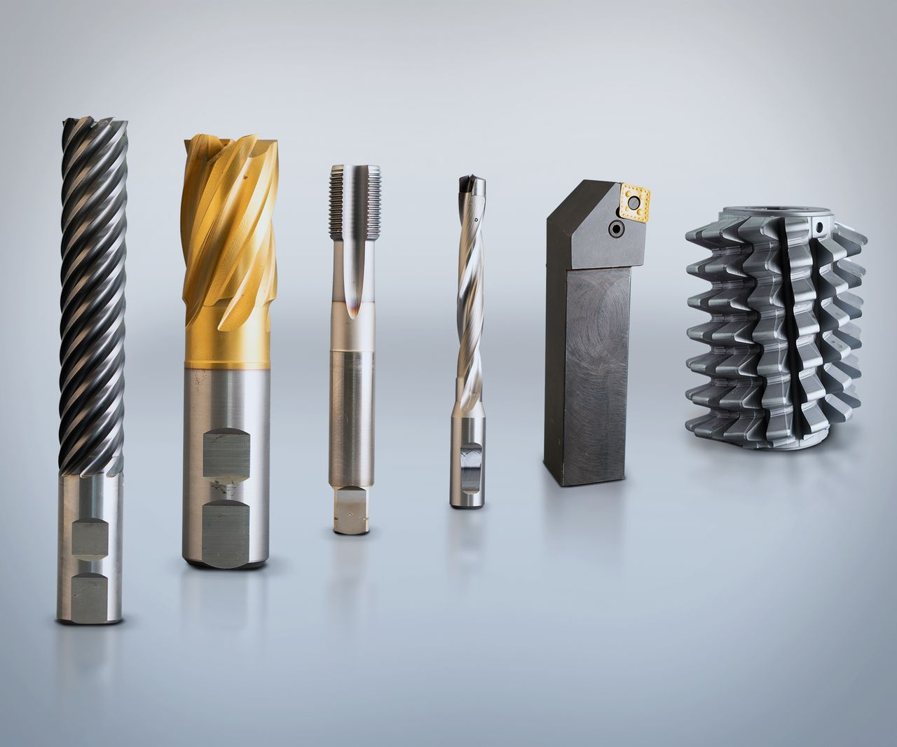 Six metal cutting tools standing next to each other