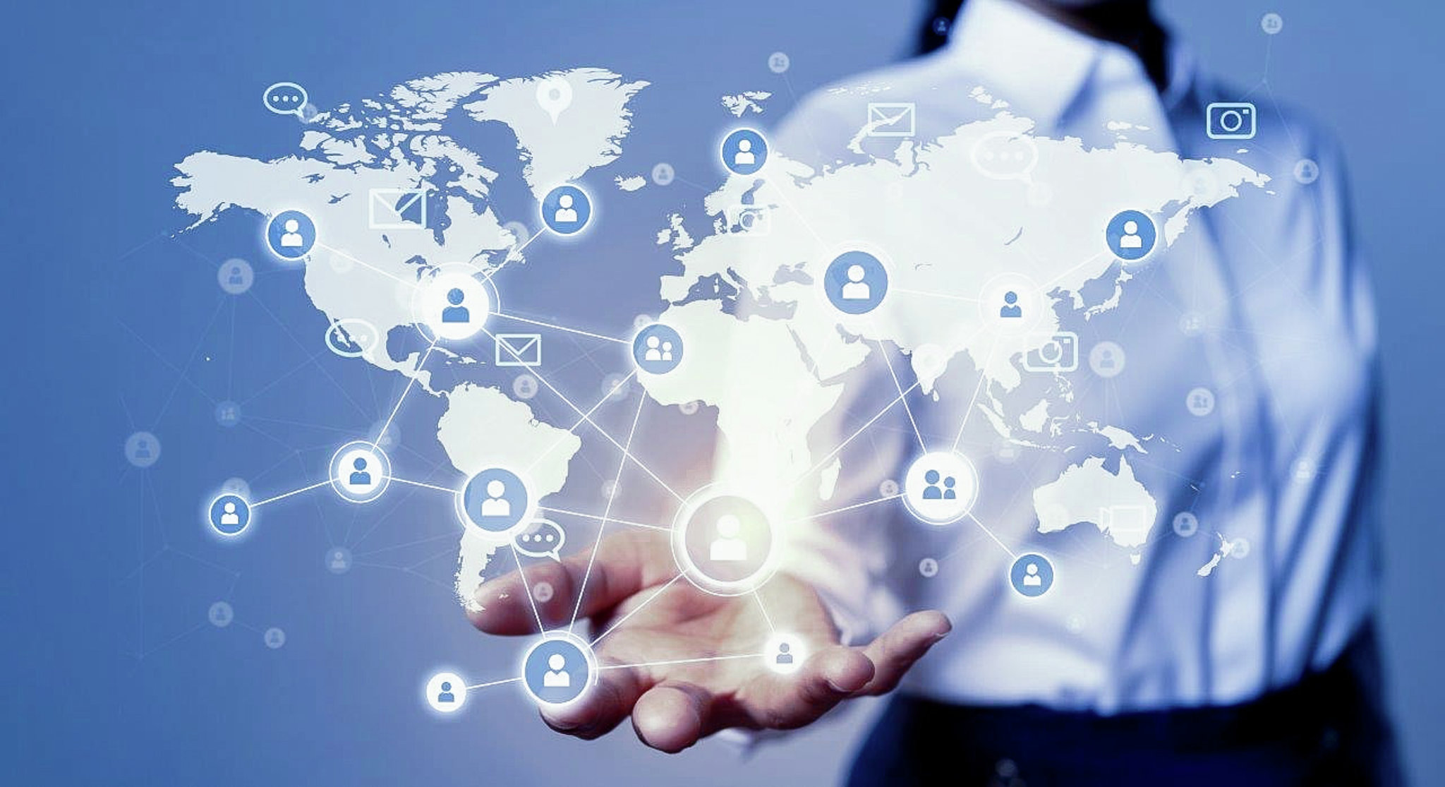 """A person wearing a blouse stretching her hand, """"holding"""" a worldmap and an organizational chart"""