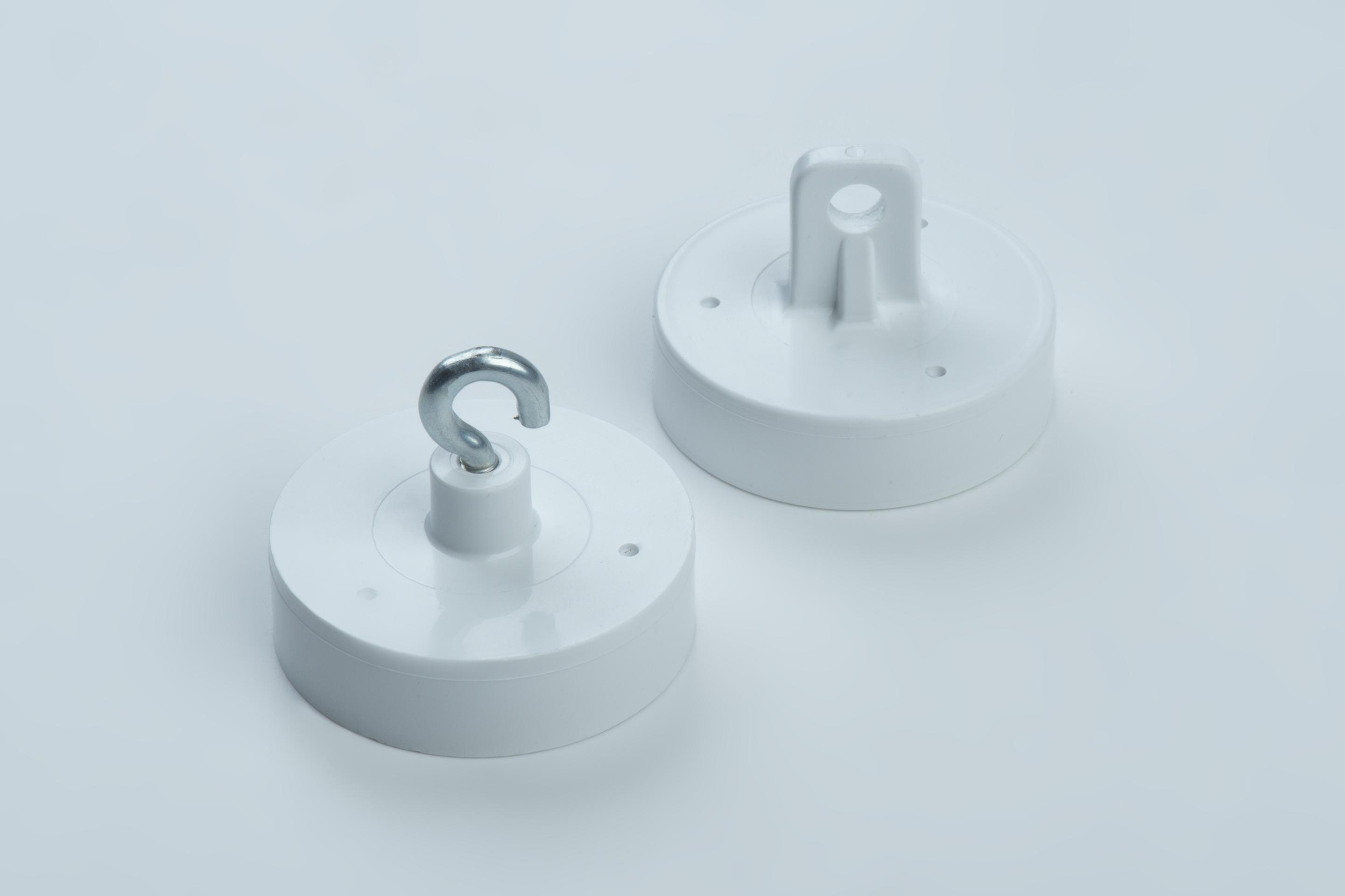 Decoration magnets made of hard ferrite, white plastic housing with hook or eyelet, thyssenkrupp Magnettechnik